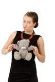 Attractive smiling brunette holding teddy bear Stock Photography