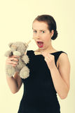Attractive smiling brunette holding teddy bear Royalty Free Stock Photo