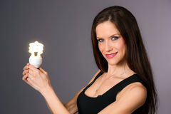 Attractive Smiling Brunette Woman Holding Green Energy Fluorescent Stock Photo