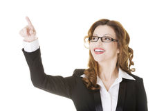 Attractive smiling businesswoman making choose Stock Images