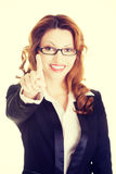 Attractive smiling businesswoman making choose Stock Photo