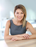 Attractive smiling businesswoman at office Royalty Free Stock Photography