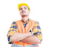 Attractive smiling engineer standing with arms crossed and act c. Onfident with copy paste on white background Stock Photos