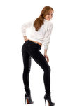 Attractive smiling girl in black tight jeans stock image