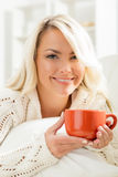 Attractive smiling girl with a cup of tea Stock Photos
