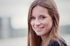 Attractive smiling girl Stock Photos