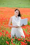 Attractive smiling girl with laptop Royalty Free Stock Images