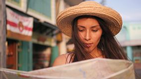 Attractive Smiling Girl Looking at City Map and Admiring Old Town Buildings. Young Mixed Race Tourist Woman Traveling in. Thailand. 4K, Slowmotion stock footage