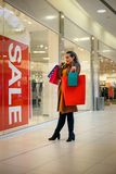 Attractive girl with shopping bag. Lifestyle Concept. Attractive smiling girl with shopping bag. Lifestyle Concept Royalty Free Stock Images