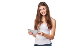 Attractive smiling girl in white shirt using tablet. Woman with tablet pc,  on white background Royalty Free Stock Photos