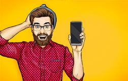 Attractive smiling hipster in specs with phone in the hand in comic style. Pop art man in hat holding smartphone. Digital advertisement male model showing the vector illustration