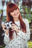 Attractive smiling hipster woman with old fashioned camera Stock Photo