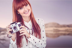 Attractive smiling hipster woman with old fashioned camera Stock Photography
