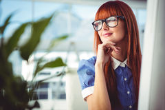 Attractive smiling hipster woman thinking Stock Photo