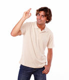 Attractive smiling latin man crossing fingers Stock Photography