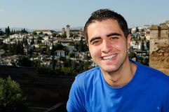 Attractive smiling man portrait in urban background Stock Images