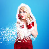 Attractive smiling miss santa. On blue background Stock Photography