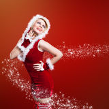 Attractive smiling miss santa. On bokeh background Stock Image