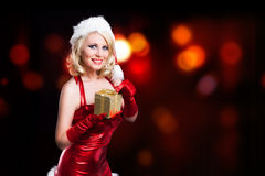Attractive smiling miss santa. With a present Stock Images