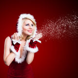 Attractive smiling miss santa. On red background Royalty Free Stock Images