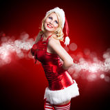 Attractive smiling miss santa Stock Images