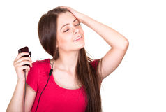 Attractive smiling teen girl listen music Royalty Free Stock Photo