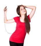Attractive smiling teen girl listen music Stock Image