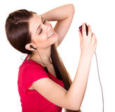 Attractive smiling teen girl listen music Stock Photos