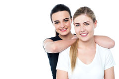 Attractive smiling teen girls facing camera Stock Photos