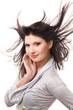 Attractive smiling woman with beautiful windy hair. Studio shot royalty free stock photo