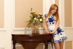 Attractive smiling woman with a bouquet of flowers Royalty Free Stock Photos