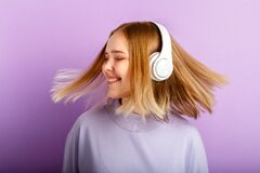 Free Attractive Smiling Woman Dancing In Headphones With Flying Blonde Hair Hairstyle. Teenager Girl Enjoy Listen Music Stock Image - 218249121
