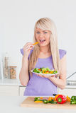 Attractive smiling woman eating her salad Stock Photo