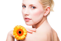 Attractive smiling woman with a flower Stock Image