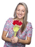 Attractive smiling woman with flowers in her hands Stock Images
