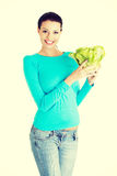 Attractive smiling woman with fresh salat Stock Photo