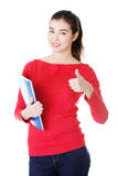 Attractive smiling woman gesturing thumb up Royalty Free Stock Images