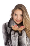 Attractive smiling woman in a gray coat royalty free stock photography