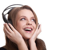 Attractive smiling woman with headphones Stock Photography