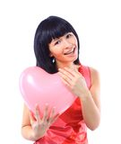 Attractive smiling woman with heart balloon Stock Images