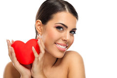 Attractive smiling woman with heart Royalty Free Stock Photography
