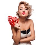 Attractive smiling woman with heart Stock Photo