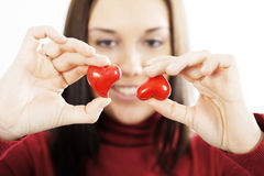 Attractive smiling woman  with hearts Royalty Free Stock Photo