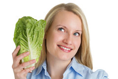 Attractive smiling woman holding fresh lettuce. Healthy food concept Royalty Free Stock Photography