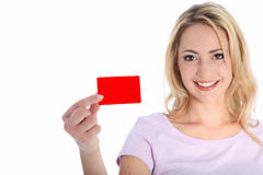 Attractive smiling woman holding a red card Royalty Free Stock Image