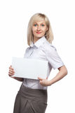 Attractive smiling woman holding white empty paper Royalty Free Stock Photos