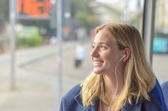 Attractive smiling woman listening to music Stock Photos