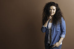 Attractive smiling woman looking sideways Stock Photography