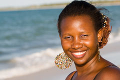 Attractive smiling woman portrait on the beach. In Tanzania Royalty Free Stock Photography