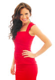 Attractive smiling woman in red dress. Stock Photography